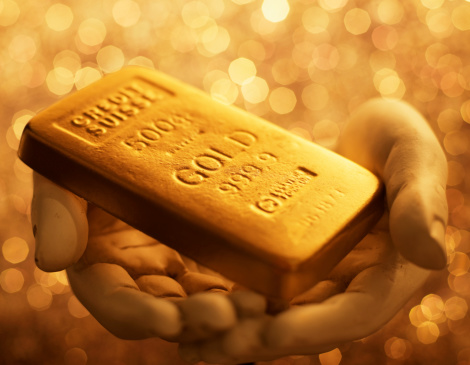 Gold Bullion In Hands
