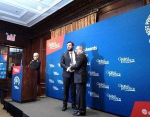 Luigi Wewege - SVP of Caye receiving Best Private Bank in Belize Award for 2019 from Global Finance publisher Joseph D. Giarraputo at The Harvard Club